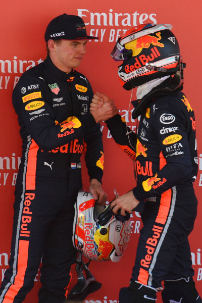 Pierre Gasly, Red Bull Racing, congratulates Max Verstappen, Red Bull Racing, 3rd position, in Parc Ferme