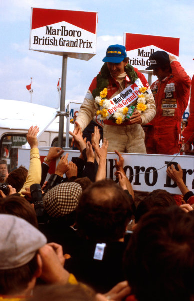 1981 British Grand Prix.Silverstone, England.16-18 July 1981.John Watson (McLaren Ford) 1st position and Carlos Reutemann (Williams Ford) 2nd position on the podium.Ref-81 GB 07.World Copyright - LAT Photographic