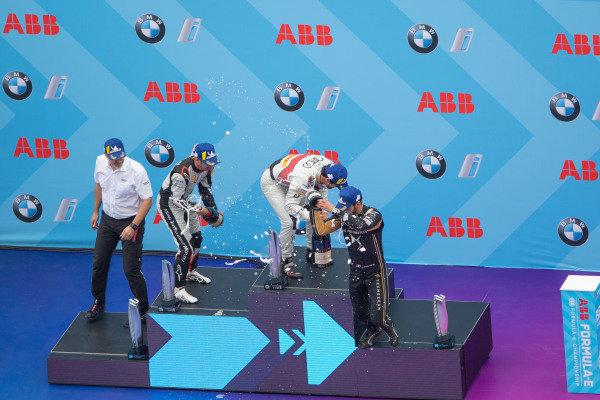 Lucas Di Grassi (BRA), Audi Sport ABT Schaeffler, 1st position, Sébastien Buemi (CHE), Nissan e.Dams, 2nd position, and Jean-Eric Vergne (FRA), DS TECHEETAH, DS E-Tense FE19, 3rd position, and Dieter Gass, Head of Audi Motorsports, celebrate on the podium