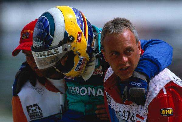 2002 Austrian Grand PrixA-1 Ring, Zeltweg, Austria. 12th May 2002Nick Heidfeld, Sauber Petronas C21, is carried away from his stricken car, after crashing heavily with Takuma Sato, Jordan Honda EJ12.World Copyright: Charles Coates/LATref: 35mm Image