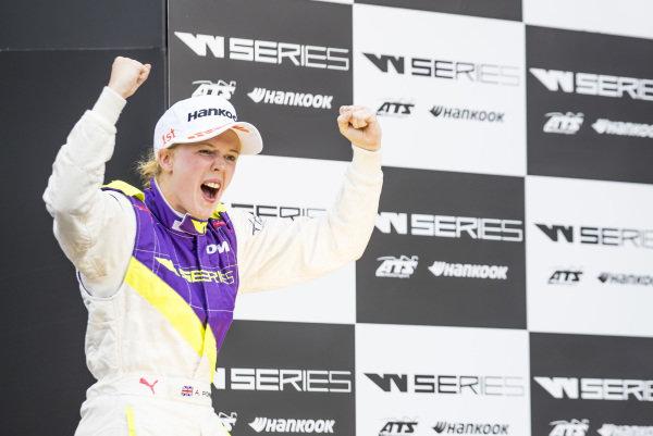 Race winner Alice Powell (GBR) celebrates on the podium