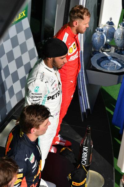 Max Verstappen, Red Bull Racing, 2nd position, Lewis Hamilton, Mercedes AMG F1, 1st position, and Sebastian Vettel, Ferrari, 3rd position, on the podium