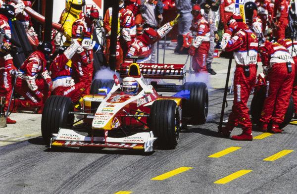 Alessandro Zanardi, Williams FW21 Supertec, leaves the pits.