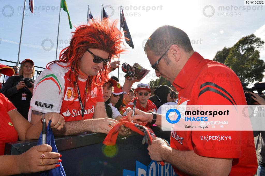 Stefano Domenicali (ITA) Ferrari General Director signs an autograph for fan Anthony Hvala (AUS). Formula One World Championship, Rd1, Australian Grand Prix, Preparations, Albert Park, Melbourne, Australia, Thursday 13 March 2014.