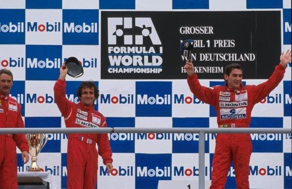 (C) Alain Prost (FRA) 2nd place. (R) Winner Ayrton Senna (BRA). (L) 3rd place Nigel Mansell (GBR) German Grand Prix, Hockenheim, 30 July 1989