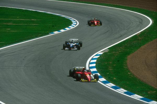 Barcelona, Spain.12-14 May 1995.Jean Alesi (Ferrari 412T2) followed by Damon Hill (Williams FW17 Renault) and Gerhard Berger (Ferrari 412T2).Ref-95 ESP 10.World Copyright - LAT Photographic