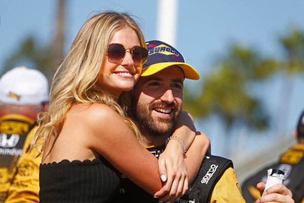 2017 Verizon IndyCar Series Toyota Grand Prix of Long Beach Streets of Long Beach, CA USA Sunday 9 April 2017 James Hinchcliffe and girlfriend Rebecca Dalton World Copyright: Phillip Abbott/LAT Images ref: Digital Image lat_abbott_lbgp_0417_15155