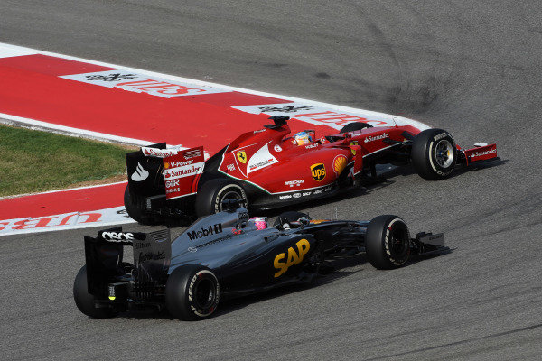 Jenson Button (GBR) McLaren MP4-29 and Fernando Alonso (ESP) Ferrari F14 T battle. Formula One World Championship, Rd17, United States Grand Prix, Race, Austin, Texas, USA, Sunday 2 November 2014. BEST IMAGE