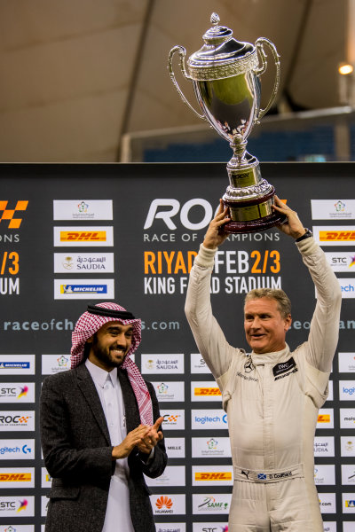 2018 Race Of Champions King Farhad Stadium, Riyadh, Abu Dhabi. Saturday 3 February 2018 David Coulthard (GBR) is presented with the winners trophy on the podium. Copyright Free FOR EDITORIAL USE ONLY. Mandatory Credit: 'Race of Champions'