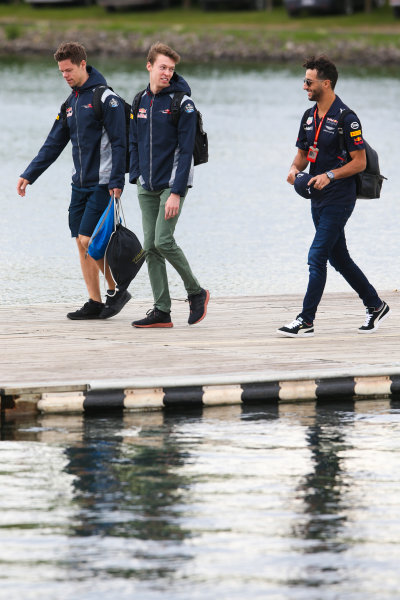 Circuit Gilles Villeneuve, Montreal, Canada. Friday 9 June 2017. Daniil Kvyat, Toro Rosso, and Daniel Ricciardo, Red Bull Racing, arrive at the circuit. World Copyright: Charles Coates/LAT Images ref: Digital Image DJ5R5606