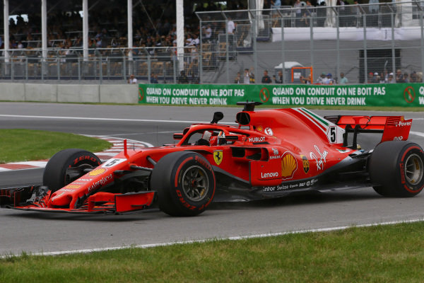 Race winner Sebastian Vettel (GER) Ferrari SF-71H waves at the end of the race .