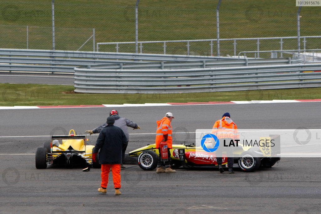 2013 FIA F3 European Championship, Silverstone, Northamptonshire. 12th - 14th April 2013. Sandro Zeller (CH) Jo Zeller Racing Dallara Mercedes and Sean Gelael (RI) Double R Racing Dallara Mercedes collide at the start of Race 1. World Copyright: Ebrey / LAT Photographic.