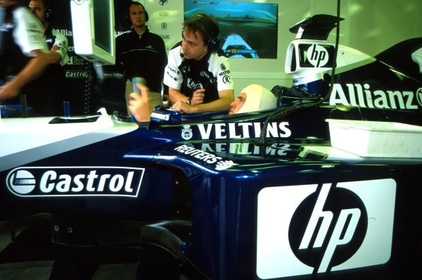 Ralf Schumacher (GER) Williams BMW FW24 studies the times during qualifying.