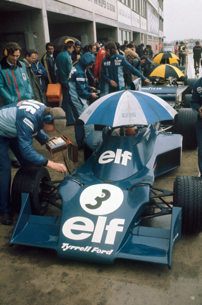 1974 Belgian Grand Prix  Nivelles-Baulers, Belgium. 10-12th May 1974.  Jody Scheckter, Tyrrell 007 Ford, and Jacky Ickx, Lotus 76 Ford, in the pits.  Ref: 74BEL09. World Copyright: LAT Photographic