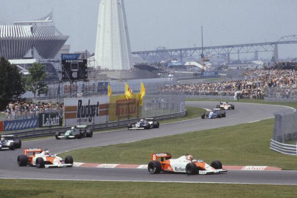 1983 Canadian Grand Prix  Montreal, Canada. 10-12 June 1983.  Niki Lauda (McLaren MP4-1C Ford), leads team-mate John Watson, Roberto Guerrero (Theodore N183 Ford), Danny Sullivan (Tyrrell 011 Ford), Johnny Cecotto (Theodore N183 Ford), Raul Boesel (Ligier JS21 Ford), and Mauro Baldi, (Alfa Romeo 183T).  Ref: 83CAN16. World Copyright - LAT Photographic