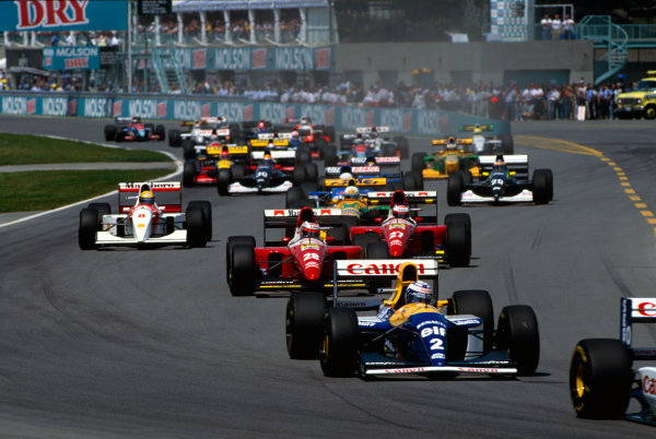 Montreal, Quebec, Canada. 11-13 June 1993. Damon Hill leads Alain Prost (both Williams FW15C Renault's), Gerhard Berger, Jean Alesi (both Ferrari F93A's), Ayrton Senna (McLaren MP4/8 Ford) and Riccardo Patrese (Benetton B193B Ford) at the start. Ref-93 CAN World Copyright - LAT Photographic