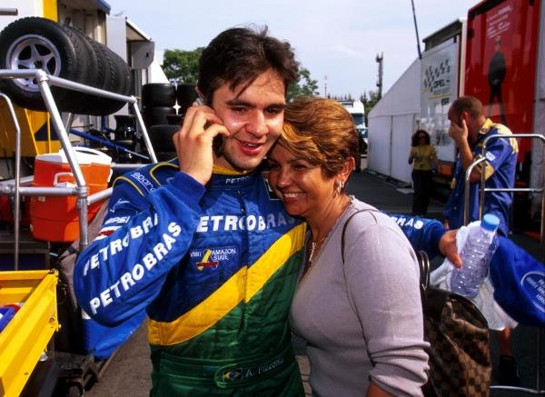 Antonio Pizzonia (BRA) Petrobras Junior Team celebrates his first F3000 victory with his mother whilst he phones a friend to inform them of his success.International Formula 3000 Championship Rd 9, Hockenheim, Germany, 28 July 2001.BEST IMAGE