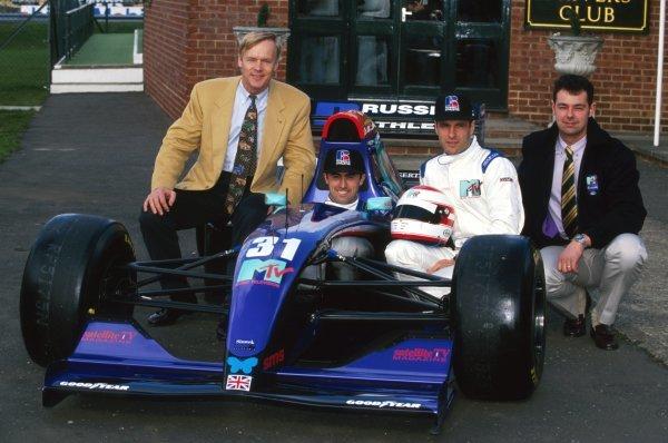 The Simtek team announce their new sponsors (L to R): Ari Vatanen (FIN); David Brabham (AUS); Roland Ratzenberger (AUT); Nick Wirth (GBR) Simtek Team Principal. Formula One World Championship, Silverstone, England, 17 March 1994.