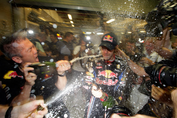 Yas Marina Circuit, Abu Dhabi, United Arab Emirates14th November 2010.Sebastian Vettel, Red Bull Racing RB6 Renault, 1st position, gets hit with champagne from every angle. Portrait. Atmosphere. World Charles Coates/LAT Photographic ref: Digital Image DX5J5754