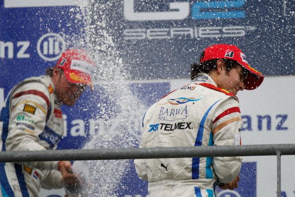 Spa - Francorchamps, Spa, Belgium. 29th August.Sunday Race.Sergio Perez (MEX, Barwa Addax Team) celebrates his victory with team mate Giedo Van der Garde (NED, Barwa Addax Team) on the podium. Photo: Andrew Ferraro/GP2 Media Service.Ref: __Q0C5462 jpg