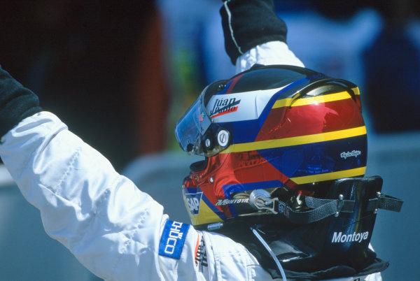 2005 British Grand Prix. Silverstone, England. 8th - 10th July 2005 Juan Pablo Montoya, McLaren Mercedes MP4-20 celebrates victory. World Copyright: PICME/LAT Photographic Ref: 35mm Image A10