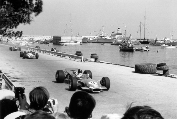 1968 Monaco Grand Prix.Monte Carlo, Monaco. 26 May 1968.Graham Hill, Lotus 49B-Ford, 1st position, leads John Surtees, Honda RA301, retired, and Jo Siffert, Lotus 49-Ford, retired, action.World Copyright: LAT PhotographicRef: 815C #19