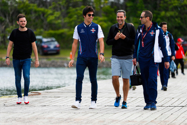 Lance Stroll, Williams Racing, arrives at the circuit with colleagues.