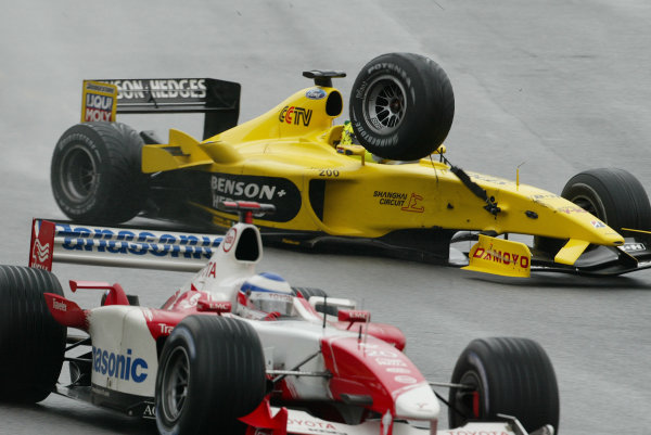 2003 Brazilian Grand Prix. Interlagos, Sao Paulo, Brazil.4-6 April 2003.Ralph Firman (Jordan EJ13 Ford) has a nasty moment as his front right suspension fails at high speed on the main straight. He continued to slide out of control into the back of Olivier Panis (Toyota TF103).World Copyright - Steve Etherington/LAT Photographic ref: Digital Image Only