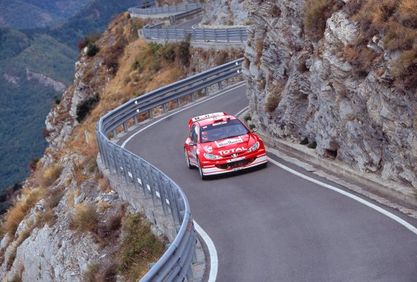 2003 World Rally ChampionshipRally of San Remo, Italy. 2nd - 5th October 2003.Richard Burns / Robert Reid, Peugeot 206 WRC. Cliffs, Mountians, Corners, Twisty, armco. Action.World Copyright: McKLEIN/LATref: 35mm Image WRCSANREMO05 jpg