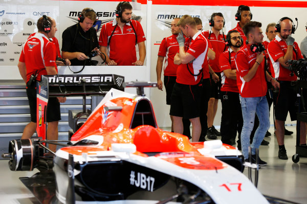 Sochi Autodrom, Sochi, Russia. Friday 10 October 2014. The Marussia team in the garage with the car of Jules Bianchi, Marussia MR03 Ferrari. World Copyright: Charles Coates/LAT Photographic. ref: Digital Image _N7T2516