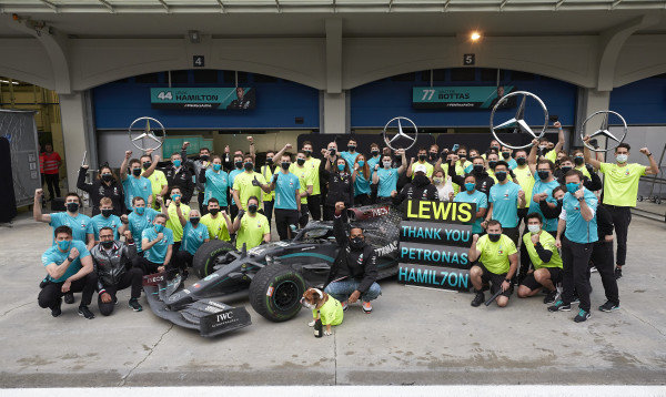 Lewis Hamilton, Mercedes-AMG Petronas F1, celebrates with his team and Valtteri Bottas, Mercedes-AMG Petronas F1 after winning his 7th championship
