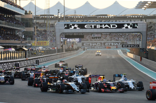 Nico Hulkenberg (GER) Force India VJM08 and Daniel Ricciardo (AUS) Red Bull Racing RB11 at the start of the race at Formula One World Championship, Rd19, Abu Dhabi Grand Prix, Race, Yas Marina Circuit, Abu Dhabi, UAE, Sunday 29 November 2015.