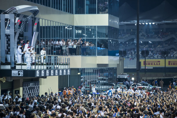 A huge crowd gathers to see Max Verstappen, Red Bull Racing, 2nd position, Lewis Hamilton, Mercedes AMG F1, 1st position, and Charles Leclerc, Ferrari, 3rd position, on the podium