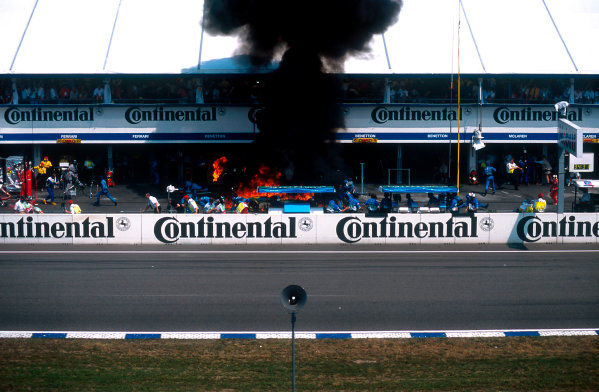 1994 German Grand Prix.Hockenheim, Germany.29-31 July 1994.Jos Verstappen (Benetton B194 Ford) came in for his pitstop. As the Refueller pulled the fuel hose away the valve stuck open allowing fuel to still come out of the nozzle and over the car which ignited into a huge fireball. The fire was delt with quite swiftly though.Ref-94 GER 42.World Copyright - LAT Photographic
