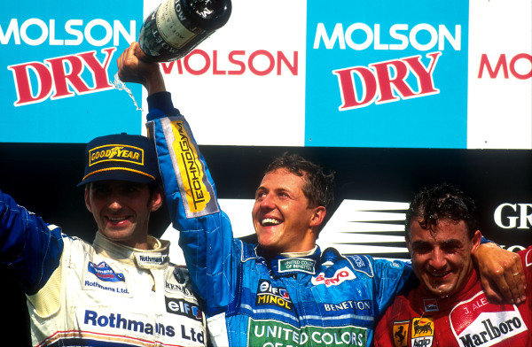 1994 Canadian Grand Prix. Montreal, Quebec, Canada. 10-12 June 1994. Michael Schumacher (Benetton Ford) 1st position, Damon Hill (Williams Renault) 2nd position and Jean Alesi (Ferrari) 3rd position celebrate on the podium. Ref-94 CAN 05. World Copyright - LAT Photographic