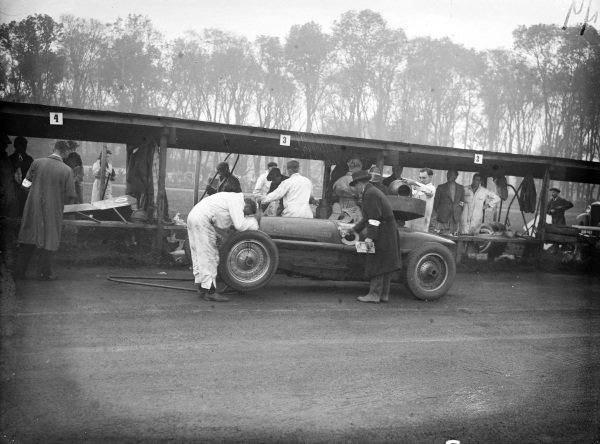 Mechanics work on and refuel the Bugatti T59 shared by Lindsey Eccles and Pat Fairfield in the pits.