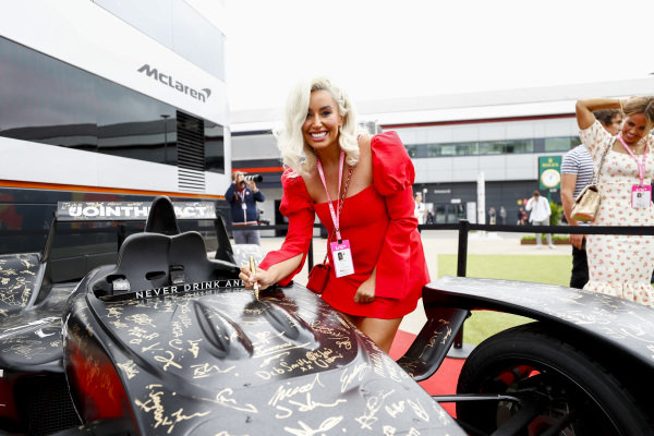 Celebrities sign the Johnnie Walker Caparo T1
