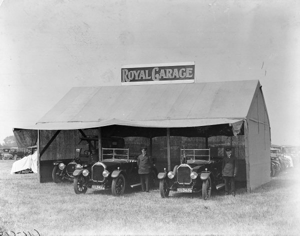 Drivers wait with Humbers in the Royal Garage as Prince Edward (later King Edward VIII) visits the 1924 Peterborough Hound Show.