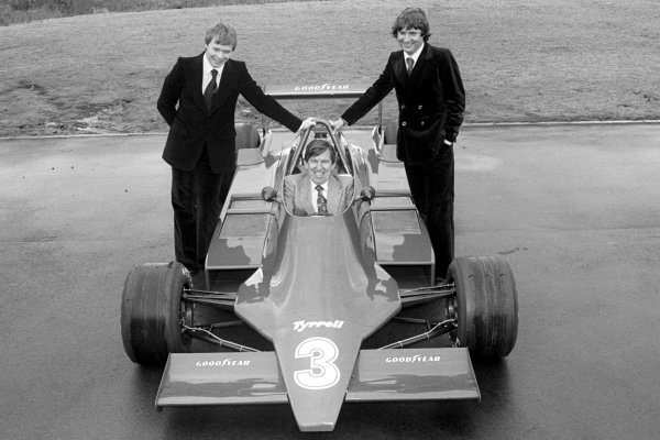 L-R: 1979 Tyrrell driver line-up Didier Pironi (FRA); Ken Tyrrell (GBR) Tyrrell Team Owner; Jean-Pierre Jarier (FRA), with the new ground effect Tyrrell 009. Tyrrell 009 Launch, England, Circa late 1978.