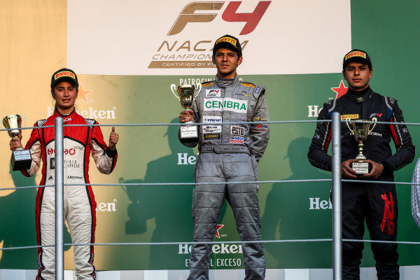 (L to R): Second placed Alexandra Mohnhaupt (MEX) Momo F4 RT, race winner Igor Fraga (BRA) Prop Car and RRK RT and third placed Santiago Lozano (COL) RPL Racing T celebrate on the podium with the trophies at Formula 4 Series, Circuit Hermanos Rodriguez, Mexico City, Mexico, 27-29 October 2017.