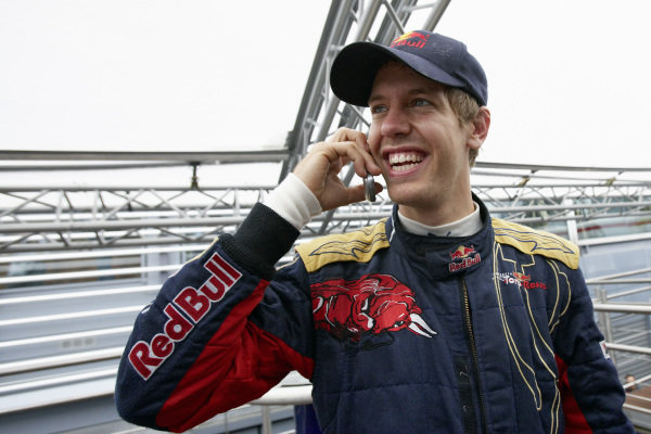 Sebastian Vettel on the phone after clinching his first pole position.