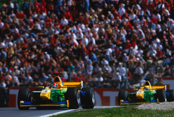 2002 F3000 ChampionshipA1-Ring, Austria. 11th May 2002.Ricardo Sperafico, battles with team mate Anonio Pizzonia (Petrobras Junior).World Copyright: Clive Rose/LAT Photographicref: 35mm Image A14