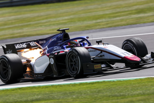 Flames stab from the exhaust of Louis Deletraz (CHE, CHAROUZ RACING SYSTEM)