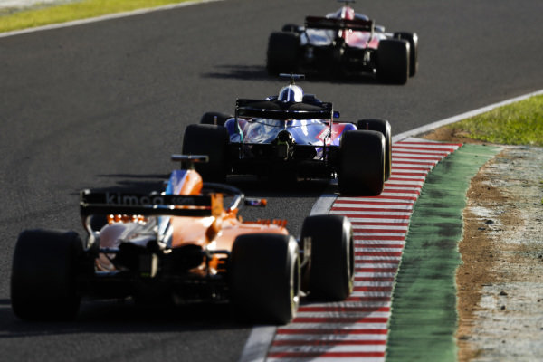 Brendon Hartley, Toro Rosso STR13 Honda, leads Fernando Alonso, McLaren MCL33