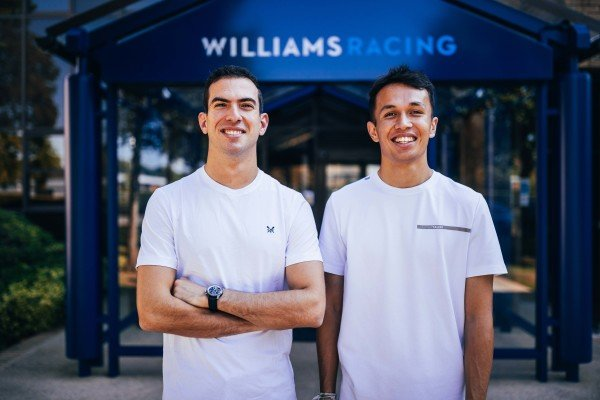 Nicholas Latifi, Williams, poses with his 2022 team-mate Alex Albon, outside of the Williams factory in Grove, Wantage, Oxfordshire. Thomas Marzusch/Williams F1
