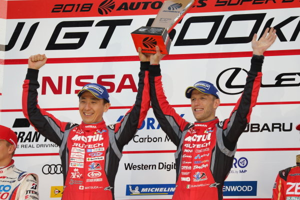 GT500 winners Tsugio Matsuda & Ronnie Quintarelli, who shared the number 23 Motel Autech NISMO Nissan GT-R, celebrate on the podium.