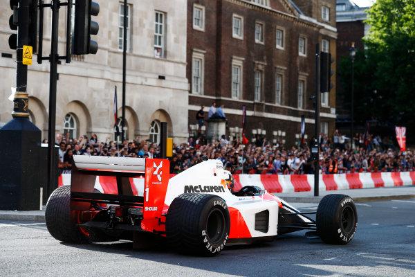London, United Kingdom.  Wednesday 12 July 2017. Stoffel Vandoorne, McLaren, demonstrates a 1991 McLaren MP4/6 that was raced by Ayrton Senna. World Copyright: Glenn Dunbar/LAT Images  ref: Digital Image _X4I0904
