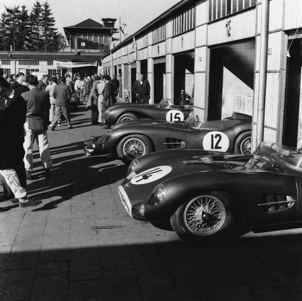 Nurburgring , Germany. 26 May 1957.The Tony Brooks/Noel Cunningham-Reid (Aston Martin DBR1), 1st position in the garages along side the Roy Salvadori/Les Leston (Aston Martin DBR1), 6th position and the Peter Whitehead/Graham Whitehead (Aston Martin DB3S), 9th position, action. World Copyright: LAT Photographic.Ref:  Autocar Glass Plate C49309