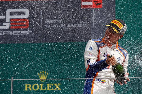 2015 GP3 Series Round 2.  Red Bull Ring, Spielberg, Austria.  Sunday 21 June 2015. Oscar Tunjo (COL, Trident) celebrates his win on the podium. Photo: Sam Bloxham/GP3 Media Service  ref: Digital Image _G7C5950