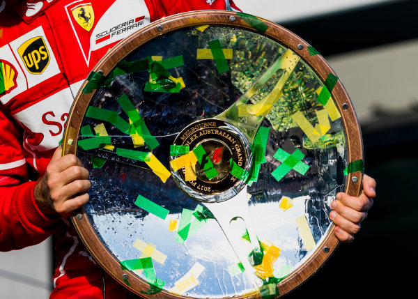 Albert Park, Melbourne, Australia. Sunday 26 March 2017. Sebastian Vettel, Ferrari, 1st Position, with his trophy. World Copyright: Zak Mauger/LAT Images ref: Digital Image _94I2503